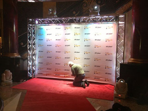 Putting the final touches on a red carpet installation